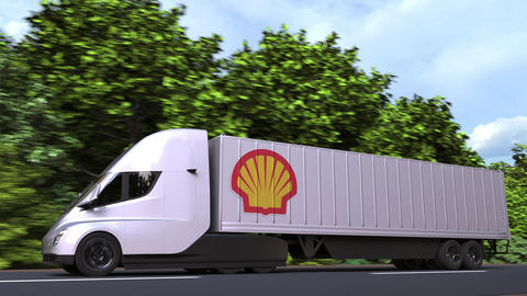 Electric trailer truck with ROYAL DUTCH SHELL logo on the side. Editorial GIF
