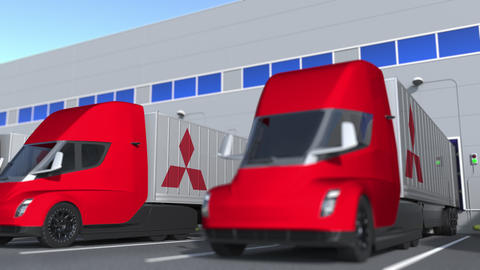 Modern semi-trailer trucks with Mitsubishi logo being loaded or unloaded at GIF