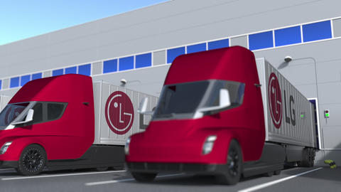 Semi-trailer trucks with LG logo being loaded or unloaded at warehouse GIF