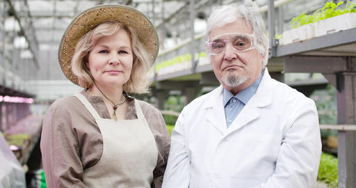Portrait of senior Caucasian woman in straw hat and man in protective eyeglasses Live Action