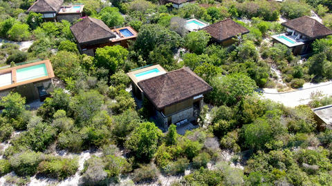 Aerial view of luxury villa with swimming pool in tropical forest Live Action