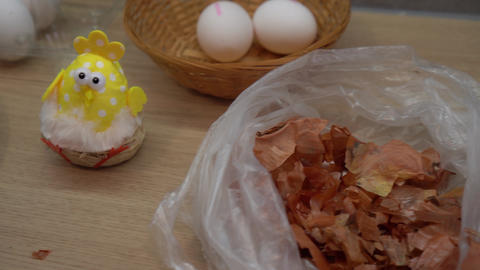 Beautiful painted eggs and ecological easter egg coloring equipment. Gimbal shot Live Action