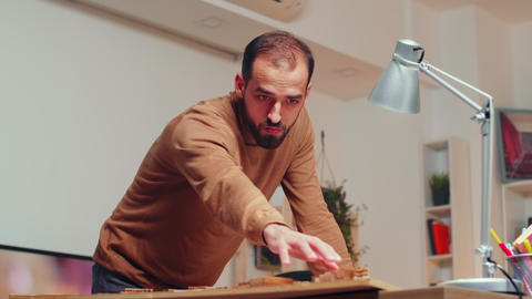Professional male architect working on a city model GIF