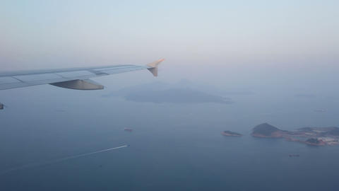 View of the ocean and islands from the plane window Live Action