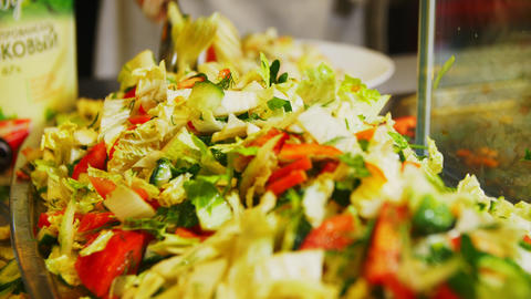 worker mixes delicious salad with chinese cabbage in cafe GIF