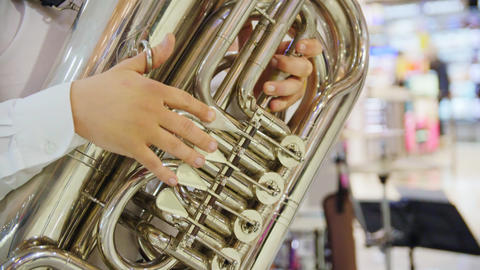 musician in white shirt plays saxophone in shopping mall GIF