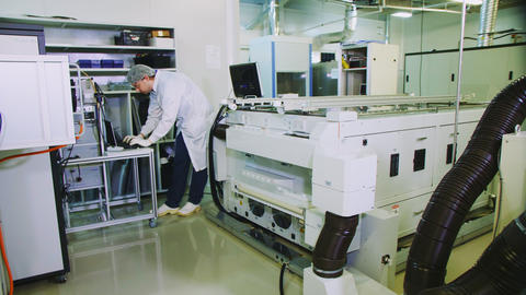 employee works on computer at solar panel production plant Live Action