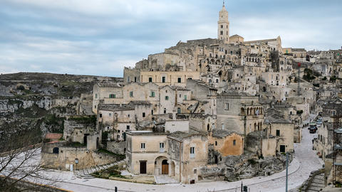 High view of of old matera town,italy,people amd traffic cars motion timelapse Acción en vivo