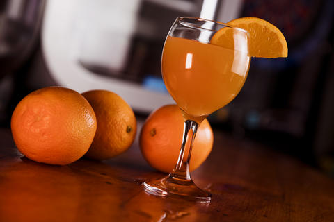 Orange Juice in the Glass with Fresh Fruits, Oranges in the Background Fotografía