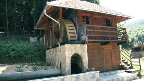 Preserved wooden watermill in the mountain GIF