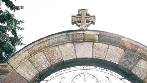 Stone Cross at the entrance gate of the monastery GIF
