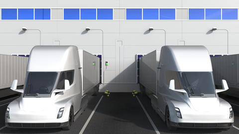 Electric semi-trailer trucks at warehouse loading bay with GENERAL ELECTRIC GE Live Action