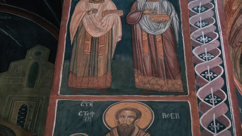 Holy icons drawn on a pillar in a monastery GIF