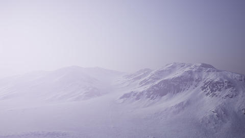 Aerial Landscape of snowy mountains and icy shores in Antarctica GIF