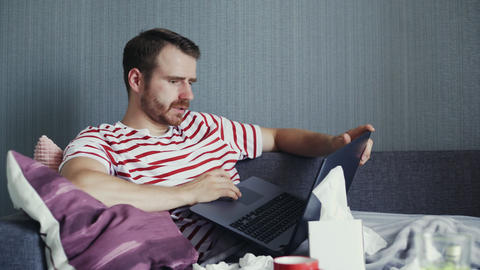 Young man working from home during illness. Online education GIF