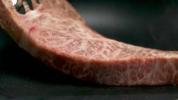 Scene of baking marbled steak Live Action