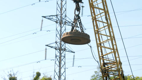 4k footage of big electric magnet hanging on high crane used for carrying and Live Action