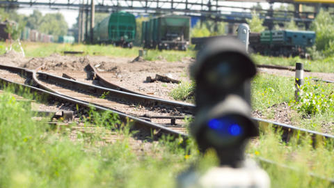 4k footage of camera focusing from long cargo trains on railroad to semaphore Live Action