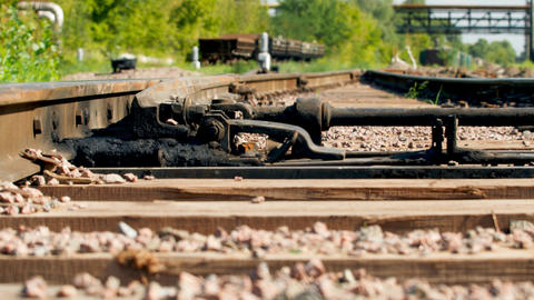 Closeup 4k dolly video of old railroad and wooden sleepers on hot sunny day Live Action