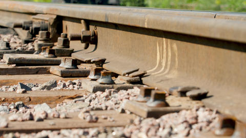 4k closeup dolly video old rusty rails and wooden sleepers on railroad station Live Action