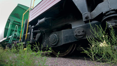 4k video of riding long cargo train with big train cars used for coal Live Action