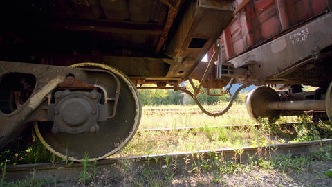 4k dolly video of old rusty cargo train car on abandoned railroad. Concept of Live Action