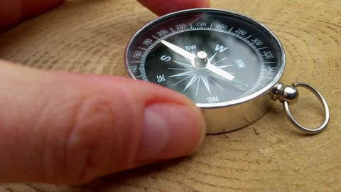Human hand and takes the compass Footage