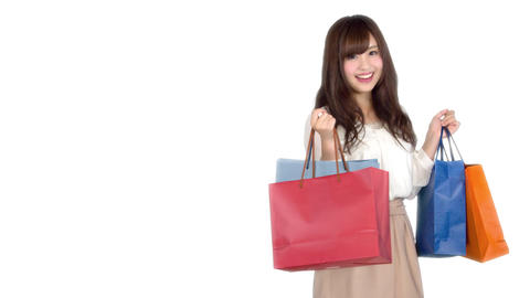Young Japanese woman shopping with colorful bag 1 Bild