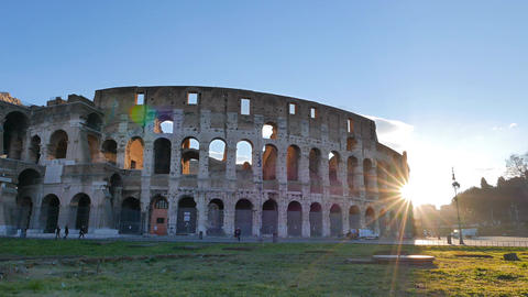 The sun comes out from behind the Coliseum. Rome, Italy Footage