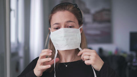 woman wearing surgical mask for corona virus isolation Live Action