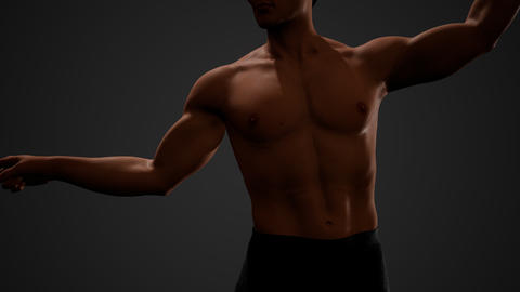 Handsome muscular shirtless young man standing in the dark GIF