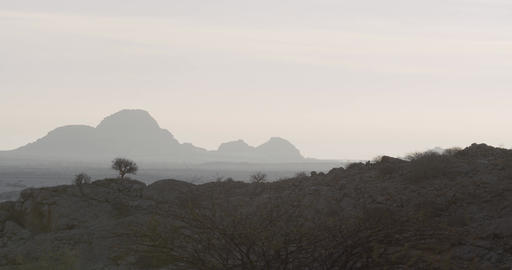 Silhouettes of the massive mountains on the horizon, fog, Namibia, 4k Live Action
