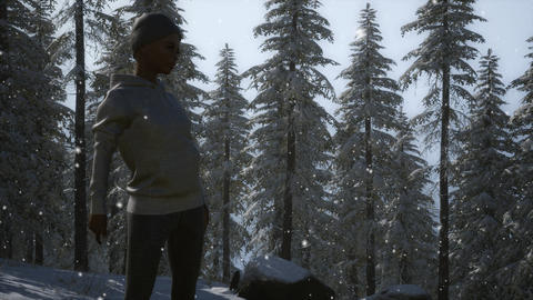 Beautiful young woman in winter forest GIF