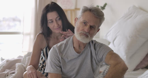Portrait of upset senior Caucasian man looking at camera and moving away wife's Live Action