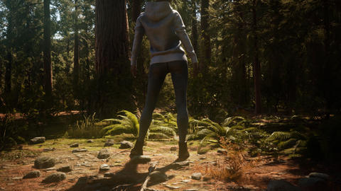 Woman in Yosimite national park near sequoia GIF