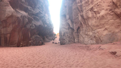 Wadi Rum, Jordan - pink cliffs and red sand in the desert part 2 Live Action