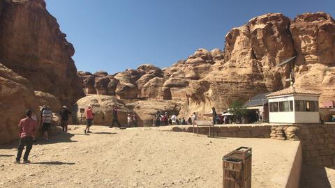 Petra, Jordan - October 17, 2019: tourists move between mountains under the Live Action