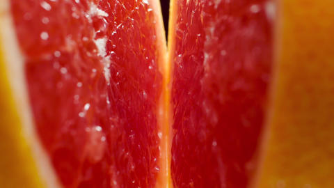 Macro video of moving between two halves of fresh tasty grapefruit. Perfect Live Action