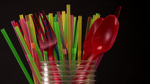 Everyday plastic waste, various plastic utensils, environmental protection Live Action