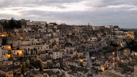Sunset view of illuminated town roofs of matera,italy,night atmosphere timelapse Live Action