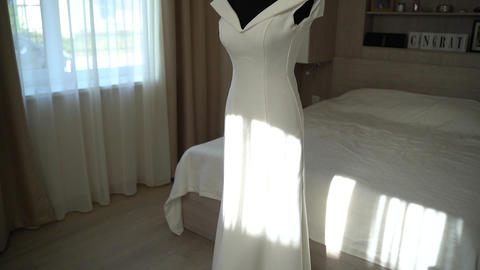 Wedding. The morning of the bride. Wedding dress on a mannequin. Bride dress Live Action