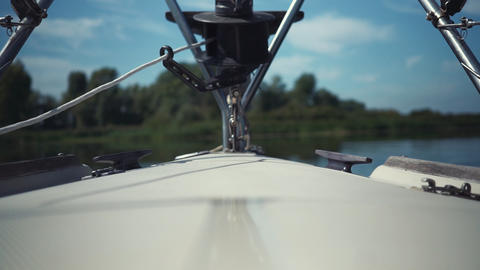 View on sailing yacht bow floating on river. Yacht turns from left to right Live Action