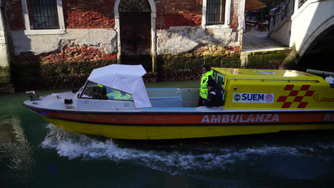 Venice / Italy - January 1 2019: Venice ambulance boat going at high speed on a narrow canal Live Action