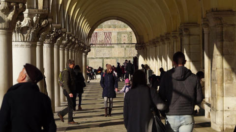 Venice / Italy - January 10 2019: Venice Italy woman and girl walks near San Marco basilica in Live Action