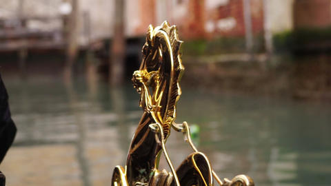Venice decoration of the gondola floating along the canal Live Action