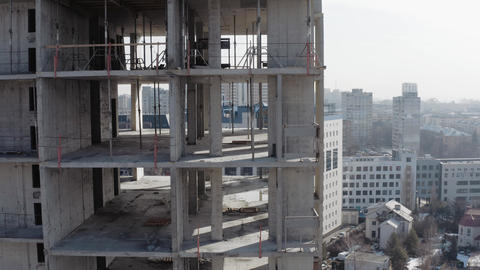 Top-down drone shooting of an unfinished multi-story building. Object under Live Action