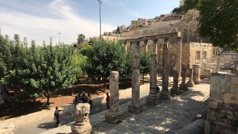 Amman, Jordan - October 20, 2019: Roman Amphitheater tourists look at the Live Action