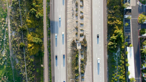 Aerial top view of highway with vehicle movement. California, USA Live Action