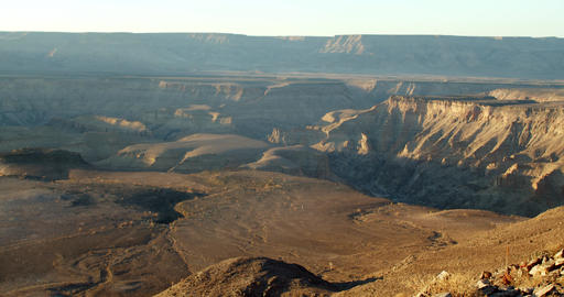 Early sunny morning, bright sun is shining on the hills and cliffs of the canyon Live Action