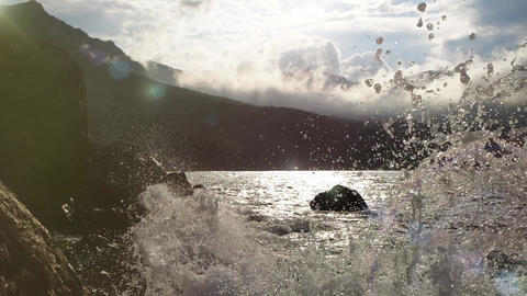Splashes of waves of the Black Sea on the rocks in slow motion. Beautiful sea Live Action